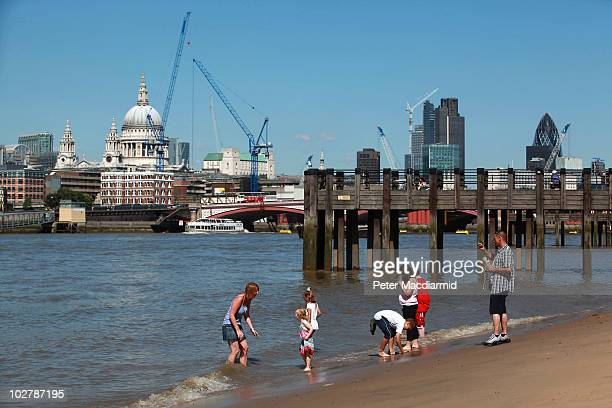 Londoners enjoy the sun on the foreshore of the River Thames near the Southbank Centre on July 10 2010 in London England With temperatures in the UK...