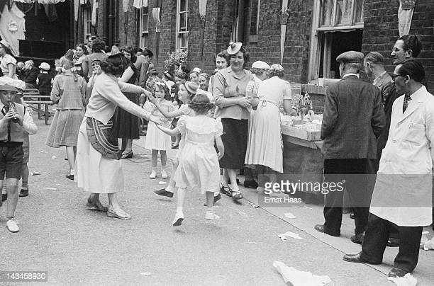 Londoners hold a street party to celebrate the coronation of Queen Elizabeth II June 1953