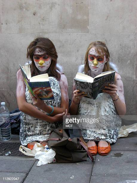 Londoners Natalie Allison left and Amy Durant came dressed as owls to the alley outside Waterstone's book store in Piccadilly Circus to await the...