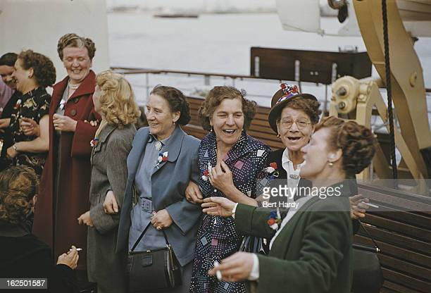 Londoners on the deck of the Royal Sovereign - a pleasure steamer taking passengers on a trip up the Thames for a day out in Southend, July 1953....