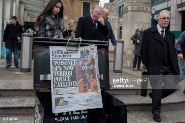 Londoners passby the London newspaper Evening Standard's latest headline about exRussian spy Sergei Skripal's suspected poisoning by Russia in...