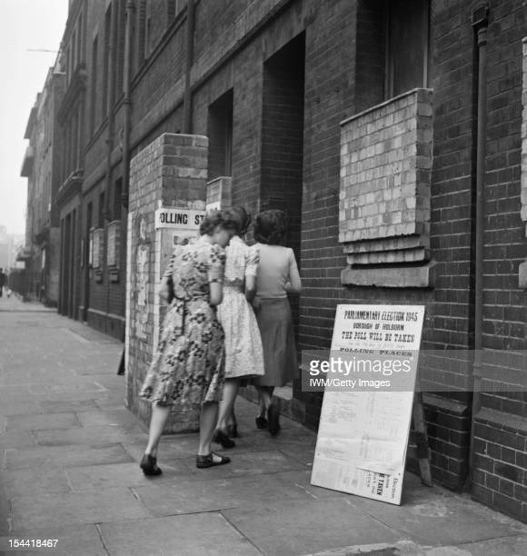 Londoners Record Their Vote On National Polling Day Holborn London England UK 5 July 1945 Three young women arrive bright and early at the polling...
