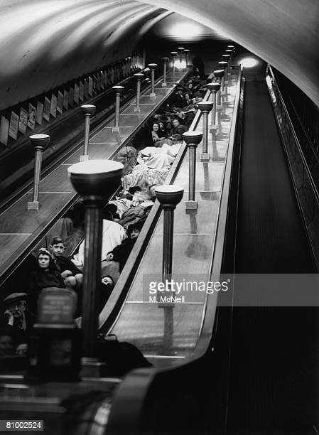 Londoners shelter from air raids in an underground station during World War II 1940