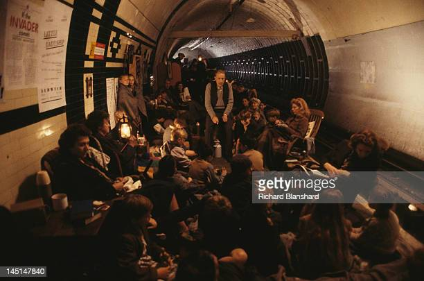 Londoners shelter in a tube station during the Blitz in a scene from 'The Krays' directed by Peter Medak 1990 Sitting at centre right is English...