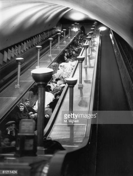 Londoners sheltering from an airraid on the stairs between escalators at Bounds Green underground station 11th October 1940