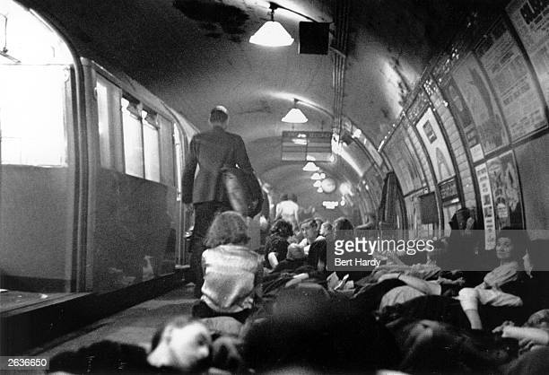 Londoners sheltering in an underground station during an air raid Original Publication Picture Post 319 And This Is A London Tube Station pub 1940