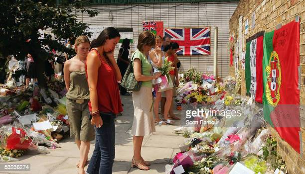 Londoners view floral tributes after standing for a twominute silence one week after the London terrorist bombings outside of King's Cross railway...