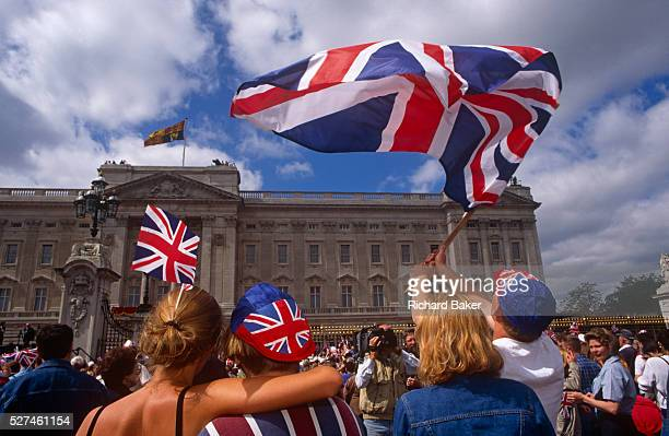 Londoners wave flags outside Buckingham Palace during 1995 VE Day 50th anniversary celebrations in London The crowd of royalists have gathered...