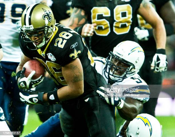 New Orleans Saints' Deuce McAllister finds his progress halted by Tim Dobbins .........