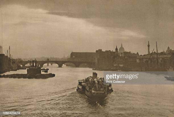 The Daily Excursion Boat Heads Into The Sunset On Its Return From Margate' circa 1935 Steamboat on the River Thames in London returning from the town...