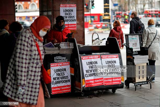 London's daily free newspaper the Evening Standard displays the message that London faces new Virus Clampdown at a distribution point in central...