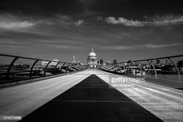 Image has been converted to black and white.) London's deserted Millenium Bridge leading to St Paul's Cathedral deserted and on lockdown as a result...