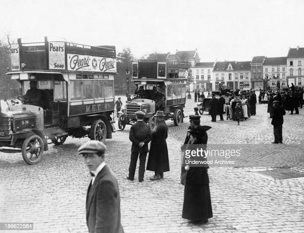 London's double decker buses are being used to evacuate Antwerp under the onslaught of the German bombardment Antwerp Belgium October 1914