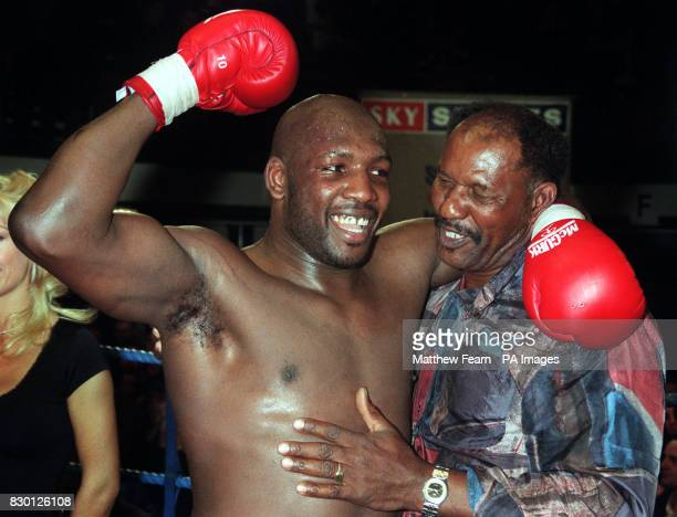 London's Julis Francis celebrates with his father Danny after successfully retaining his British and Commonwealth Heavyweight boxing titles against...
