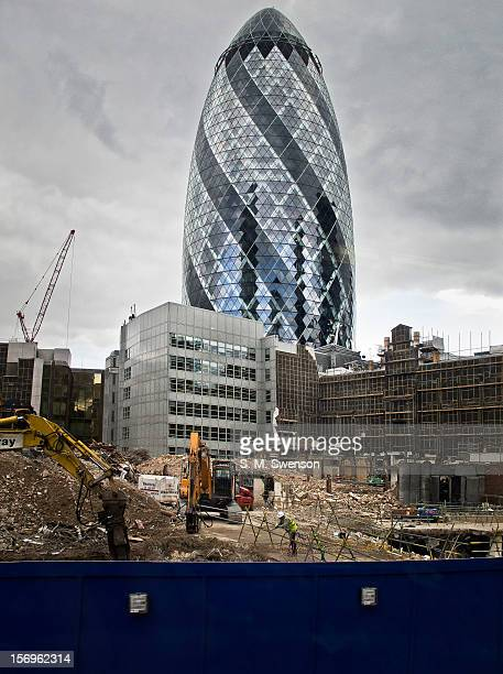 London's most iconic modern building The Gherkin and the the surrounding building site taken from the top deck of a double decker bus Located in the...