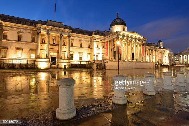 London's National Gallery at Trafalgar Square captured at night.