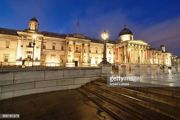 London's National Gallery at Trafalgar Square captured at night.