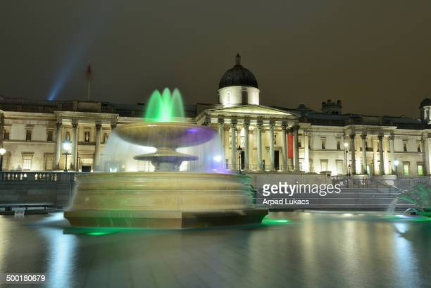 CONTENT] London's National Gallery captured at night with the Trafalgar Square fountain in the foreground