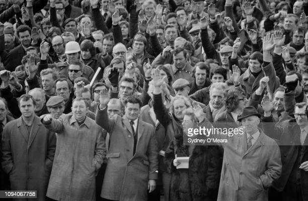 London's striking dockers voting at a meeting in Connaught Road near the Royal Albert Docks, London, UK, 18th March 1975.