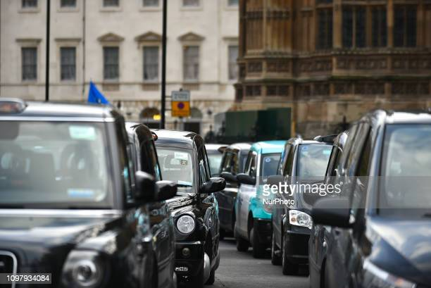 London's taxi drivers gather outside the houses of Parliament in a static protest london on February 11 2019 The Independent Workers Union of Great...