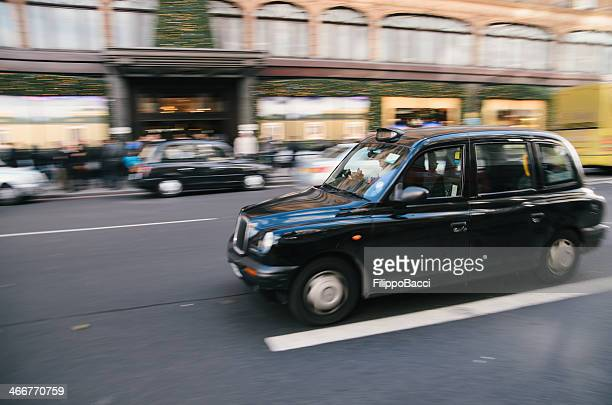 London's taxi in front of Harrods