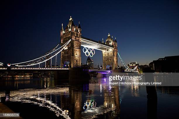 London's Tower Bridge at sunrise with the Olympic rings suspended between the towers during the 2012 Olympic games held in London.