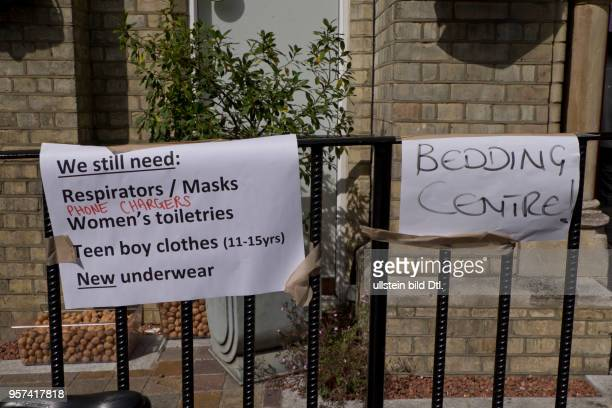 LondonUK 14th June 2017Signs with tips on practical issues next to Grenfell TowerLondonUKLondonUK 14th June 2017© Julio Etchart/Alamy Live News