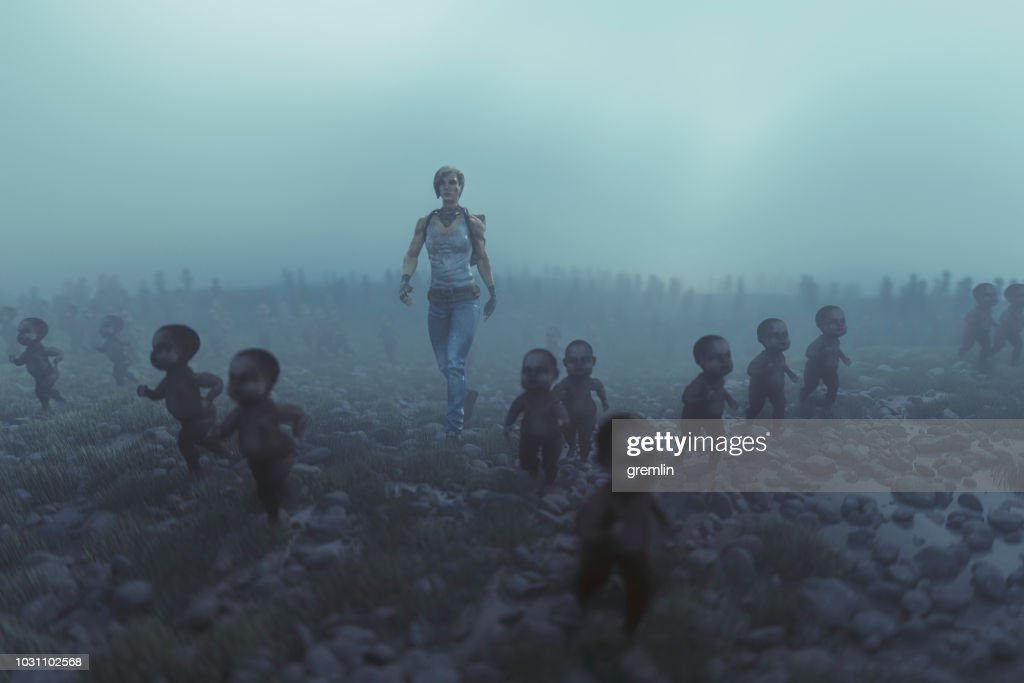 Lone apocalypse survivor with walking dead zombie children : Stock Photo
