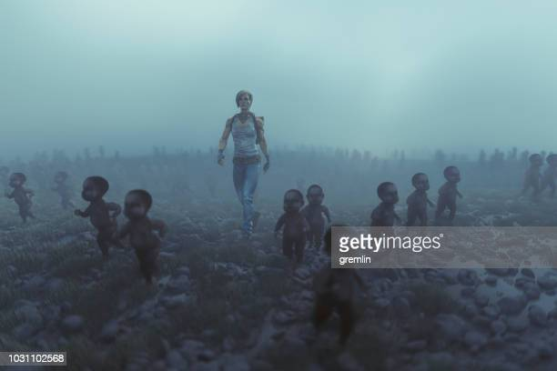 Lone apocalypse survivor with walking dead zombie children