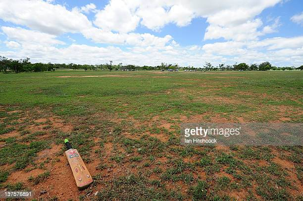 A lone bat lays abandoned on a cricket field during the 2012 Goldfield Ashes cricket competition on January 22 2012 in Charters Towers Australia...