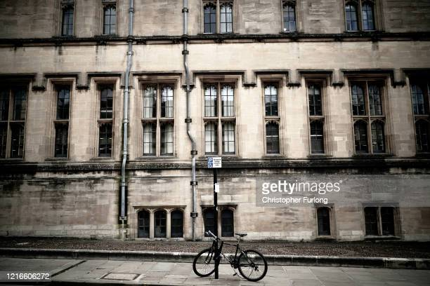 A lone bicycle stands against a post outside Christ Church after university students have been sent home and the tourists are staying away during the...