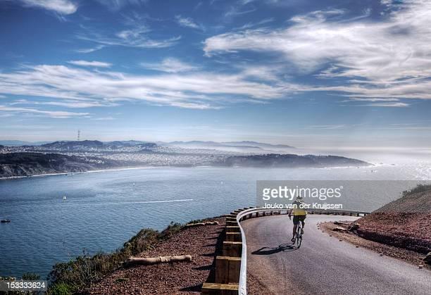 Lone biker turning corner