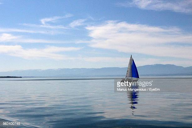 Lone Boat In Calm Blue Sea