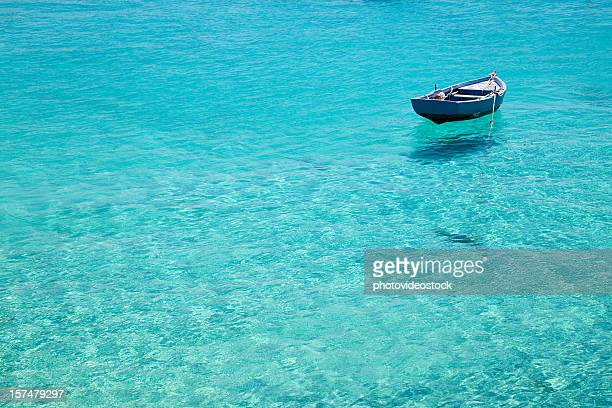 Lone boat in crystal water