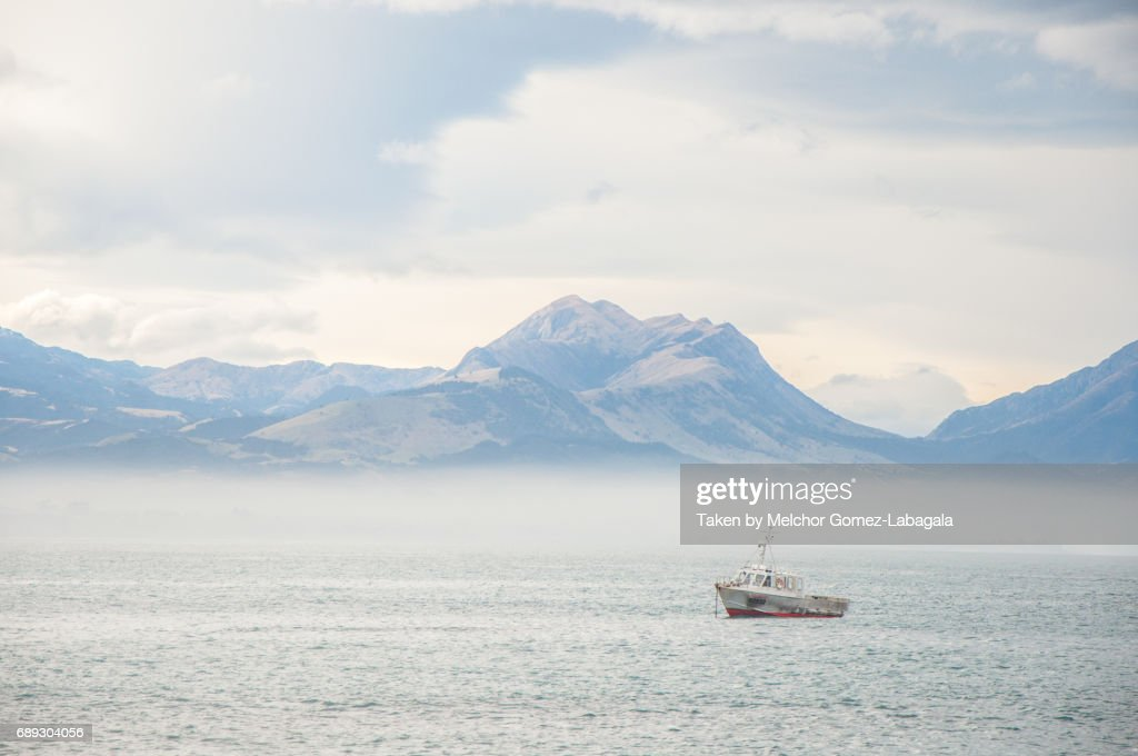 Lone Boat in Misty Waters of Kaikoura : Stock Photo