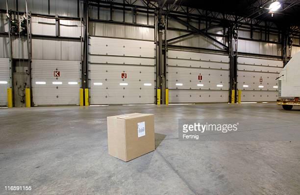 Lone box on warehouse floor