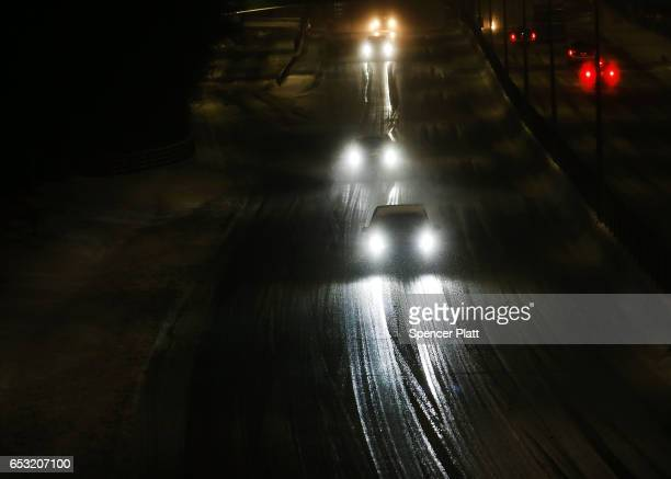 A lone car drives down a highway in the sleet and snow on March 14 2017 in New York City New York City and New Jersey are under a state of emergency...