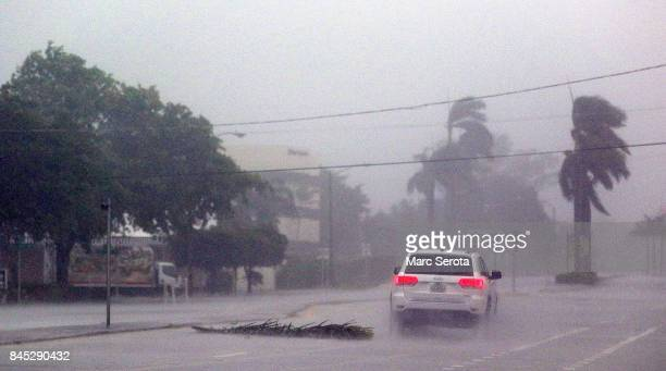 A lone car drives down a road as Hurricane Irma strikes on September 10 2017 in Boca Raton Florida Hurricane Irma made landfall in the Florida Keys...