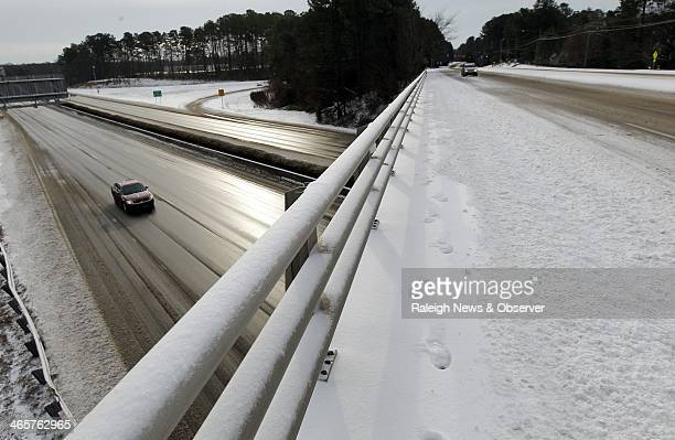 A lone car travels on the Outer Beltline at the Six Forks Rd interchange in Raleigh NC Wednesday Jan 29 2014