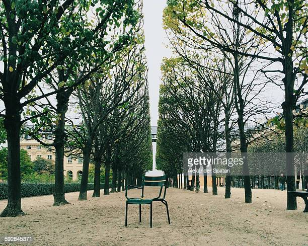 lone chair in jardin du palais royal, paris,france - palais royal stock pictures, royalty-free photos & images