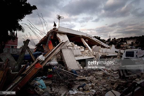 Lone chicken stands on top of the remains of a collapsed building in the hard hit Carrefour Feuilles neighborhood in Port au Prince Haiti on February...