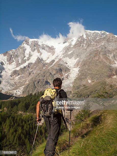 lone climber approaching a mountain - monte rosa foto e immagini stock