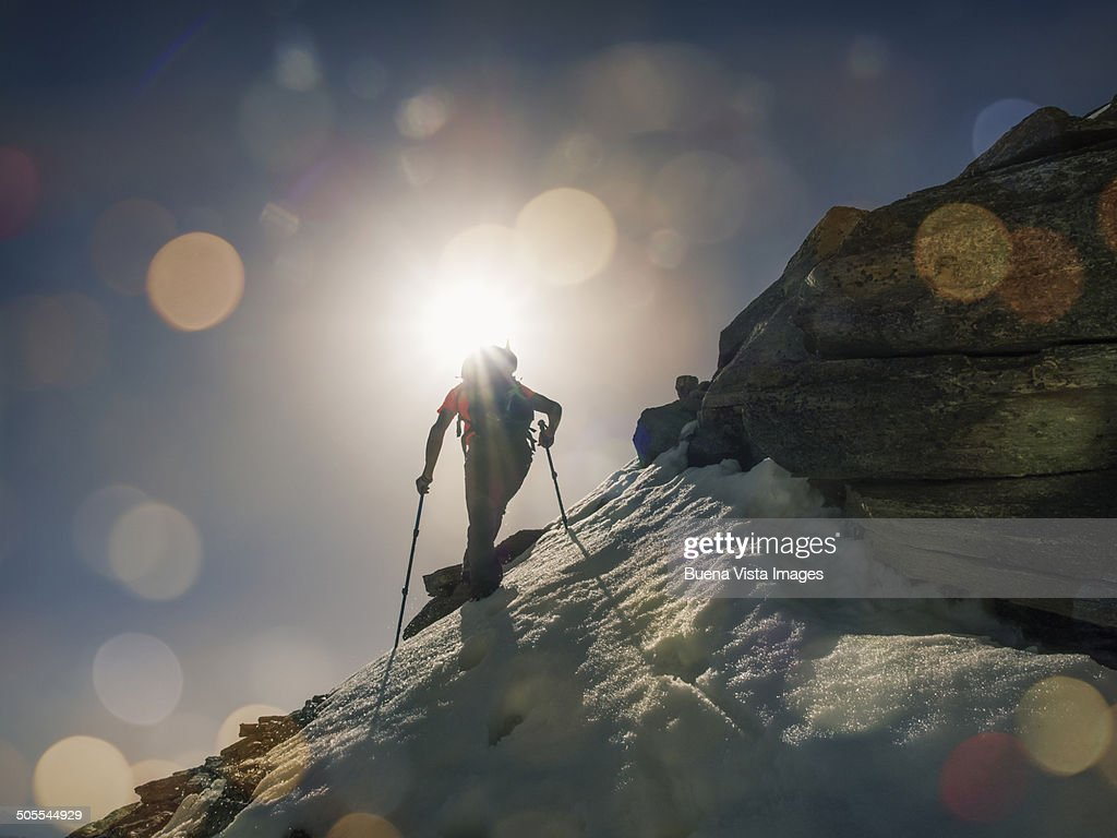 Lone climber on a mountain at sunrise