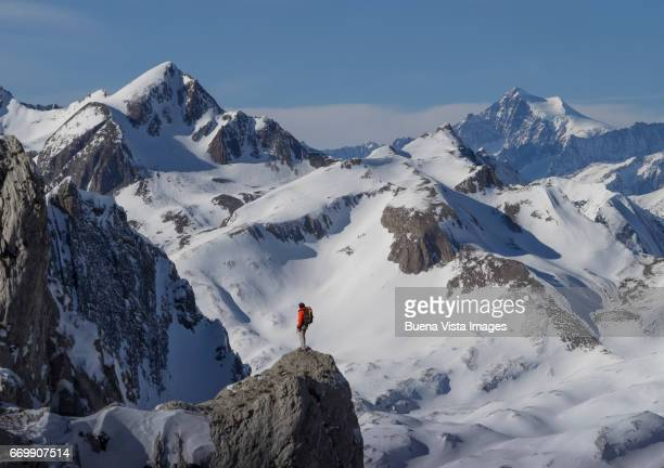 Lone climber on a mountain top