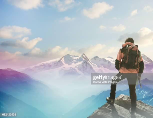 Lone climber on a rocky peak