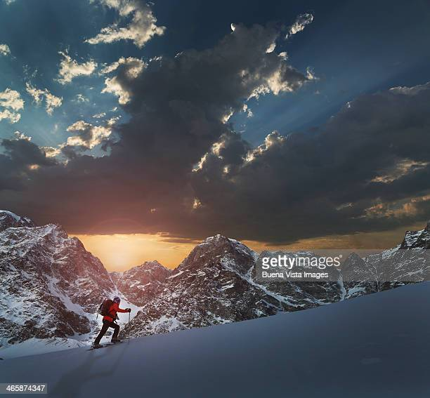 Lone climber on a snowy slope at sunrise