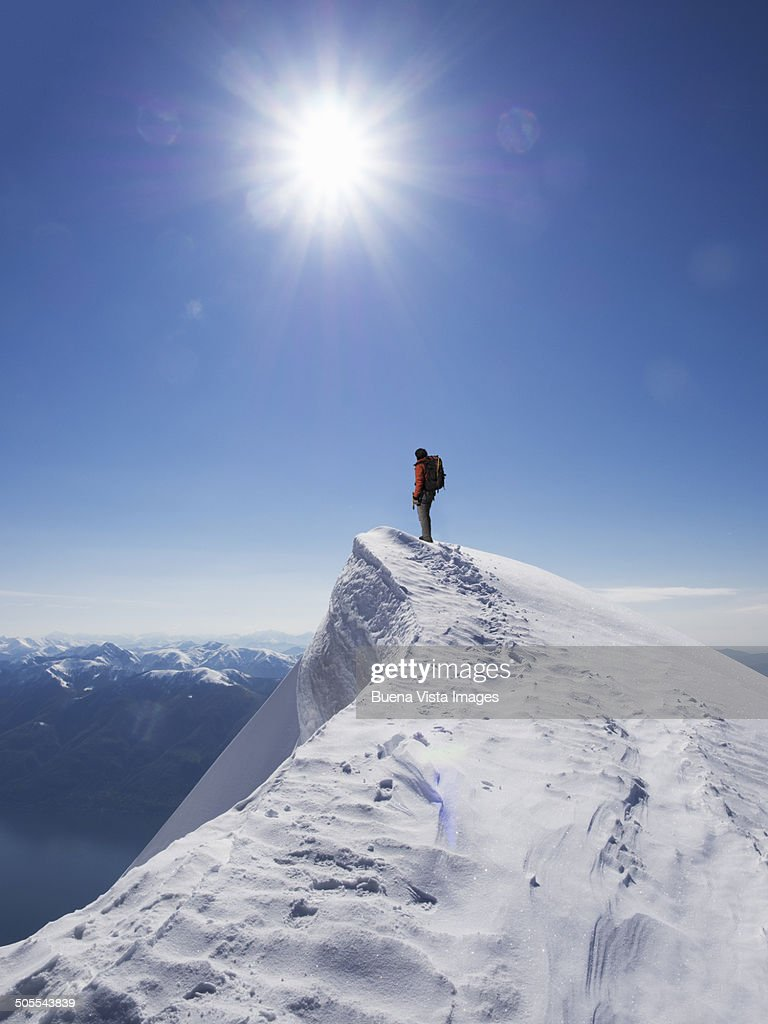 Lone climber on the top of a  mountain : Stock Photo