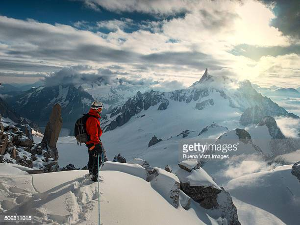 lone climber on the top of a  mountain - haute savoie stock pictures, royalty-free photos & images