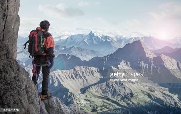 Lone climber watching a far mountain range