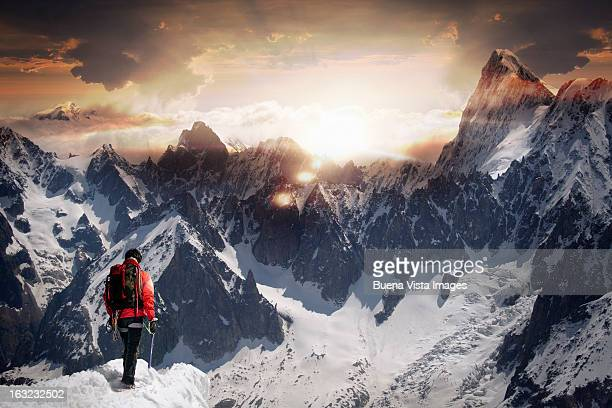 Lone climber watching a mountain sunset